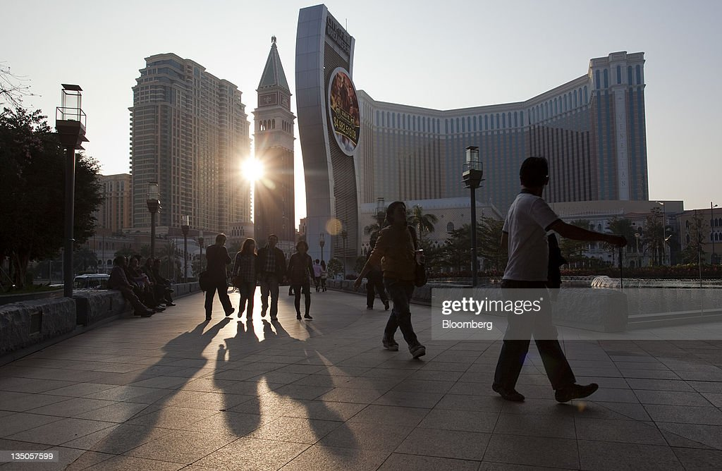 Visitors walk through the Cotai Strip in Macau, China, on Sunday, Dec. 4, 2011. Macau casino gambling revenue climbed a better-than-expected 33 percent last month as economic growth stoked demand from visitors from China's mainland. Photographer: Jerome Favre/Bloomberg via Getty Images