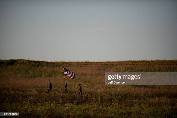 Visitors walk through the fields before a luminaria service at the Flight 93 National Memorial on September 10 2016 in Shanksville Pennsylvania...