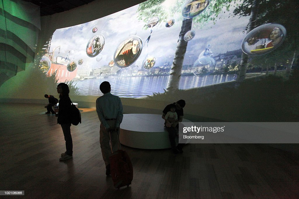 Visitors walk through the Finland Pavilion at the 2010 World Expo site in Shanghai, China, on Thursday, May 20, 2010. The 2010 World Expo will take place until October 31. Photographer: Qilai Shen/Bloomberg via Getty Images