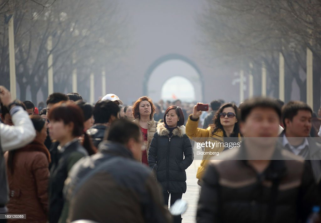 Visitors walk through the Forbidden City in Beijing, China, on Tuesday, March 5, 2013. China maintained its economic-growth target at 7.5 percent for 2013 while setting a lower inflation goal of 3.5 percent, setting up a challenge for new leaders to keep prices in check without harming expansion. Photographer: Tomohiro Ohsumi/Bloomberg via Getty Images