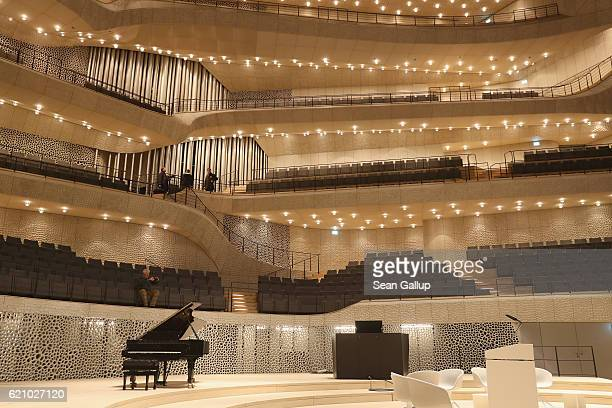 Visitors walk through the large hall of the newlycompleted Elbphilharmonie concert hall on November 4 2016 in Hamburg Germany Designed by the...