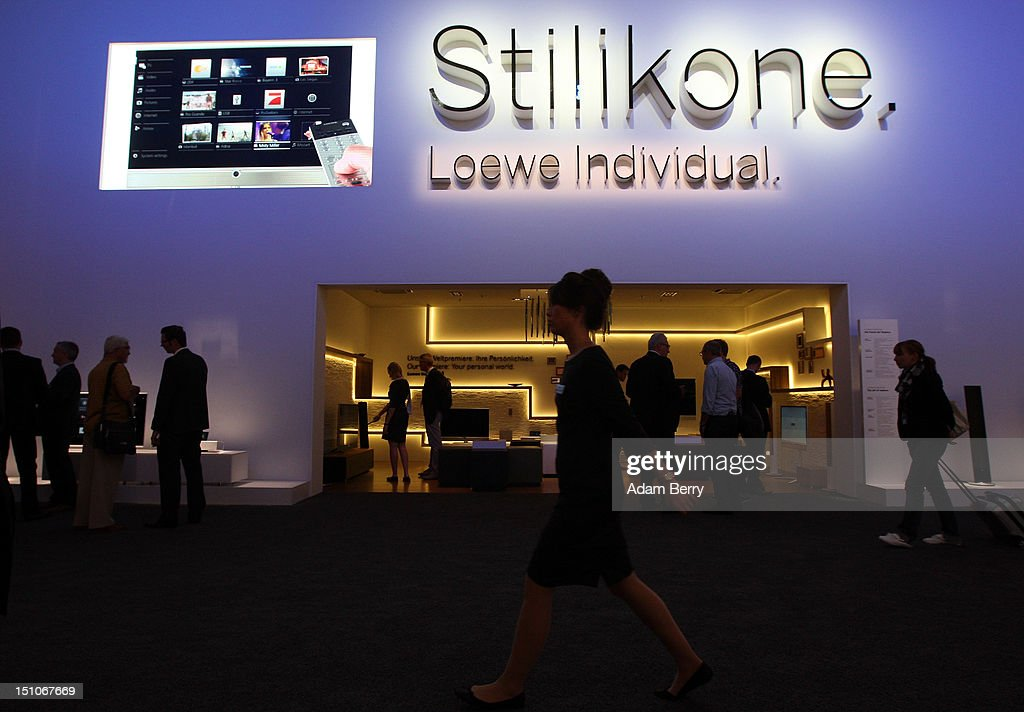Visitors walk through the Loewe stand during the Internationale Funkausstellung (IFA) 2012 consumer electronics trade fair on August 31, 2012 in Berlin, Germany. Microsoft, Samsung, Sony, Panasonic and Philips are amongst many of the brands showcasing their latest consumer electronics hardware, software and gadgets to members of the public from August 31 to September 5.