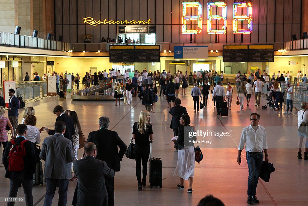 Visitors walk through the main entry hall of the Bread and Butter trade show at the former Tempelhof airport during Mercedes-Benz Fashion Week in Berlin on July 3, 2013 in Berlin, Germany.
