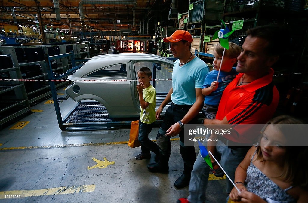 Visitors walk through the manufacturing plant of German car maker Adam Opel GmbH on September 8, 2012 in Kaiserslautern, Germany. Automaker Opel, founded in 1862, celebrates their 150th anniversary.