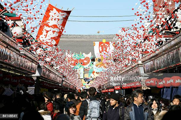 Visitors walk through the Nakamise shopping arcade leading to the Sensoji Temple on December 31 2008 in the Asakusa neighborhood of Tokyo Japan...