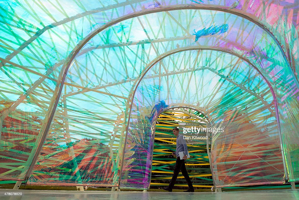 Visitors walk through the newly installed Serpentine Gallery Pavilion designed by SelgasCano on June 22, 2015 in London, England. The Pavilion which officially opens to the public from June 25, 2015, was constructed to celebrate the 15th anniversary of the Serpentine Gallery project. This year the pavilion was designed by Spanish architects Jose Selgas and Lucia Cano and takes the form of a colourful chrysalis structure.