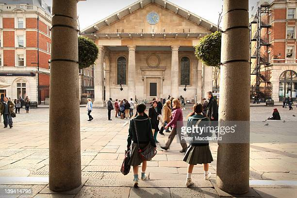 Visitors walk through the piazza at Covent Garden on February 20 2012 in London England