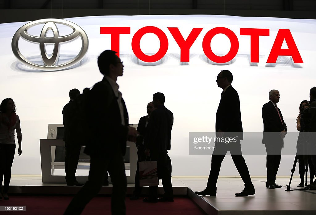 Visitors walk through the Toyota Motor Corp. stand on the first day of the 83rd Geneva International Motor Show in Geneva, Switzerland, on Tuesday, March 5, 2013. This year's show opens to the public on Mar. 7, and is set to feature more than 100 product premiers from the world's automobile manufacturers. Photographer: Valentin Flauraud/Bloomberg via Getty Images