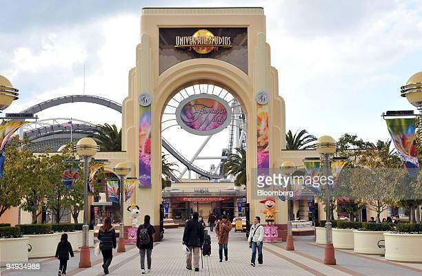 Visitors walk through the Universal Studios Japan theme park in Osaka Japan on Wednesday Jan 14 2009 Goldman Sachs Group Inc will today announce an...