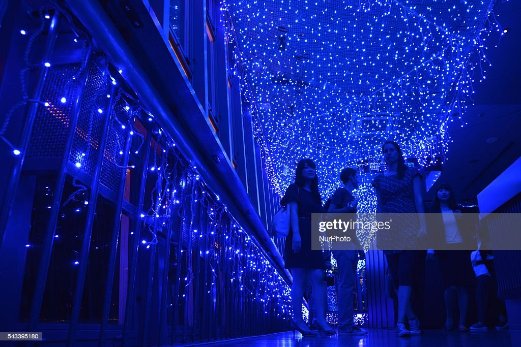 Visitors walk under illuminated Milky Way at Tokyo Tower in Tokyo, Japan, 28 June 2016. Some 160,000 blue LED lights are used for the illuminations during Tanabata Festival, or Star Festival.
