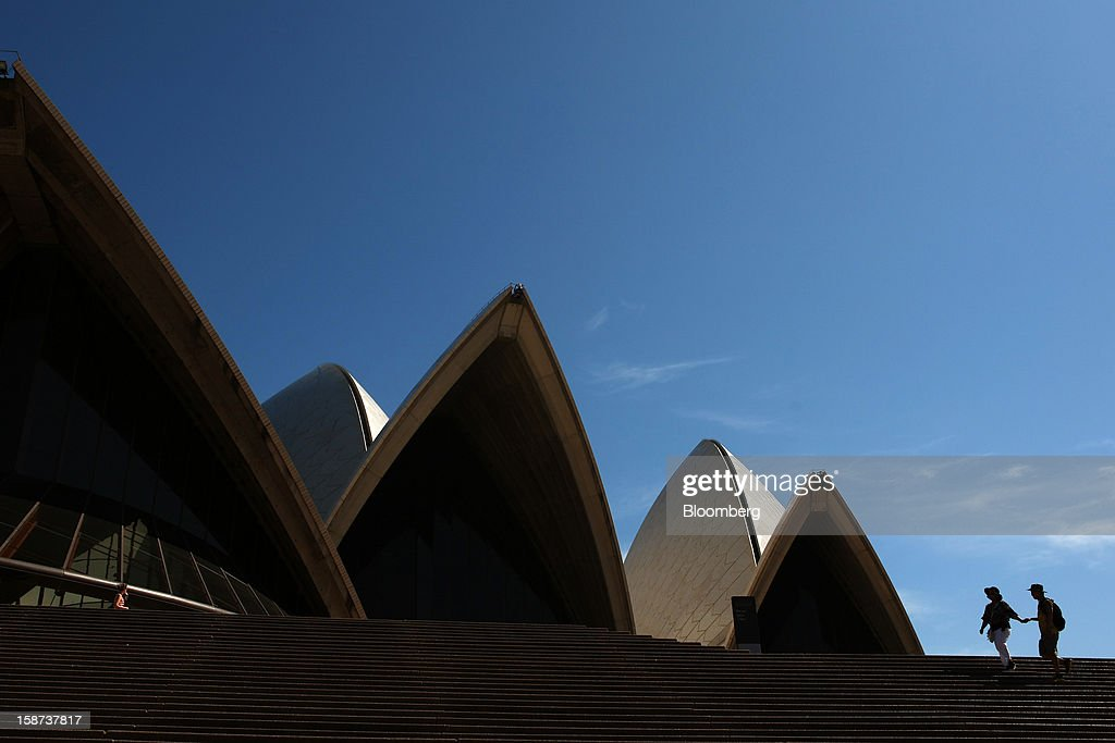 Visitors walk up a set of steps in front of the Sydney Opera House in Sydney, Australia, on Monday, Dec. 24, 2012. At least 150,000 people from mainland China and across Asia are projected to descend on Sydney, Australia's most populous city, during the New Year's Eve and Chinese New Year period. Photographer: Brendon Thorne/Bloomberg via Getty Images