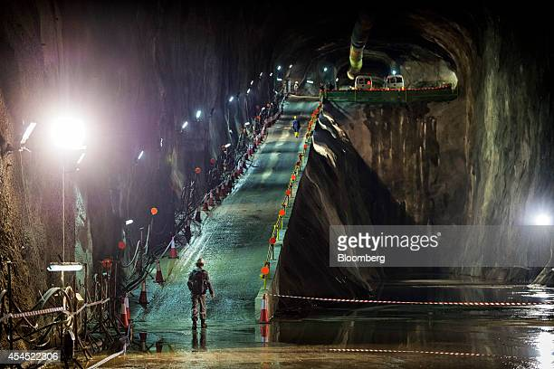Visitors walk up an illuminated ramp inside cavern 5 at JTC Corp's Jurong Rock Caverns storage facility on Jurong Island in Singapore on Tuesday Sept...