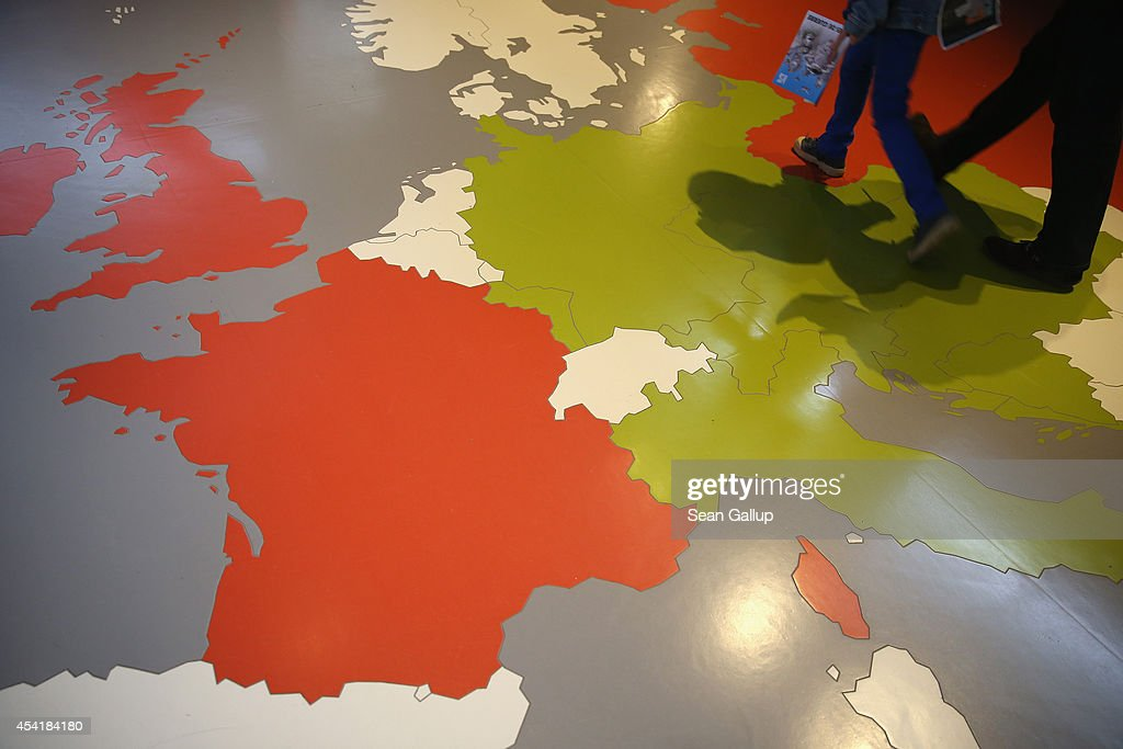 Visitors walk walk over a map showing Europe divided between the Allied and Axis powers at the outset of World War I at the Museum of the Great War...