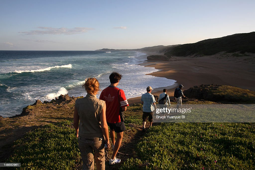Visitors walking down to Black Rock Beach, Kosi Bay.