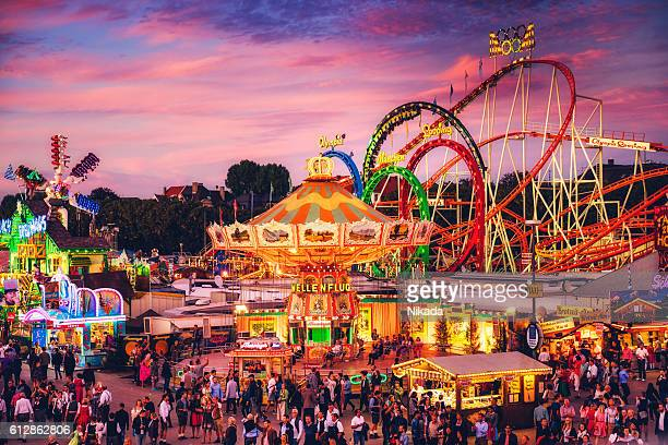 Visitors Walking Through Oktoberfest Fairgrounds, Munich, Germany