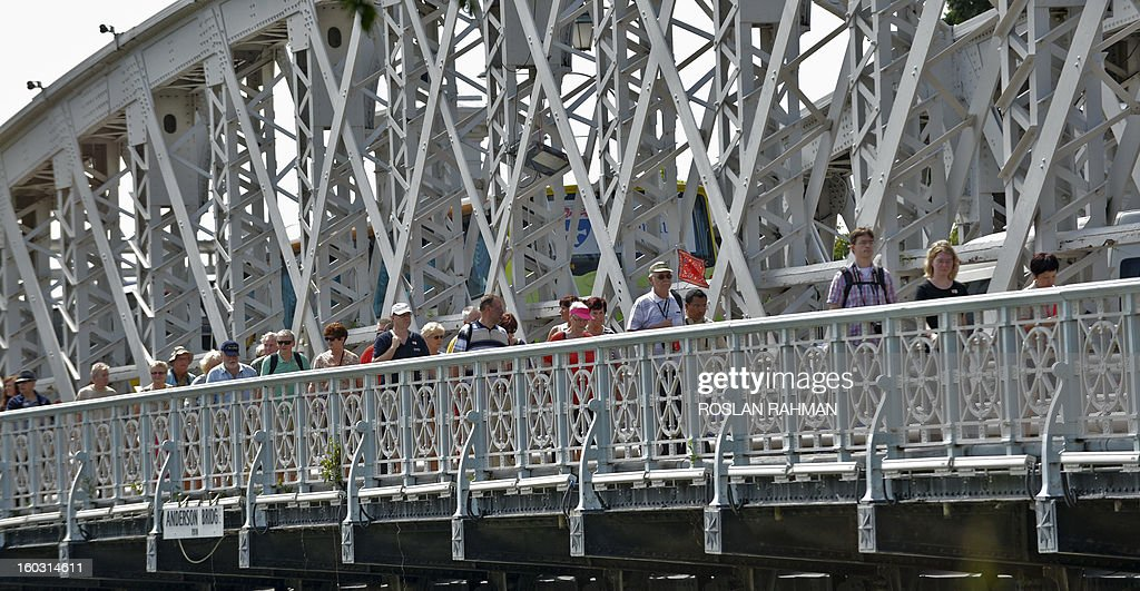 Visitors walks across the Anderson bridge in Singapore on January 29, 2013. Asia's tourism industry must prepare for major changes in the next 20 years, including a projected boom in travel by senior citizens and female business executives, a study said January 29 .