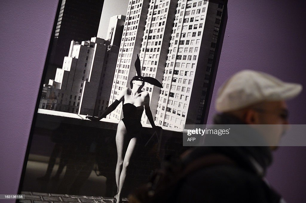 Visitors walks by a photo by German-Australian photographer Helmut Newton during a press preview of the 'White women / Sleepless nights / Big nudes' exhibition at the Palazzo delle Esposizioni on March 5, 2013 in Rome. The exhibition will run from March 6 to July 21, 2013.