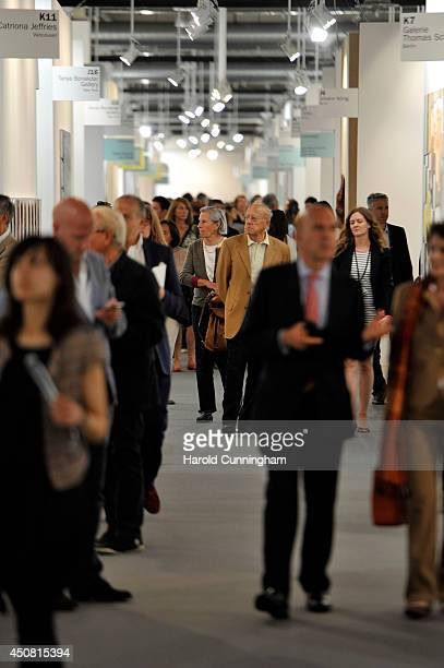 Visitors walks in an alley of the gallery section of Art Basel on June 18 2014 in Basel Switzerland Art Basel one of the most prestigious art fair in...