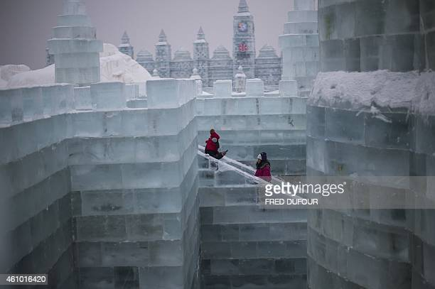 Visitors walks in an ice castle on January 4 2015 at the China Ice and Snow World on the eve of the opening ceremony of the 16th Harbin International...