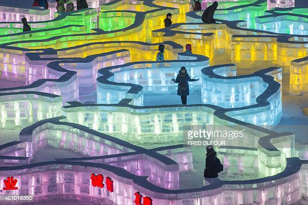 Visitors walks in an ice mazeat the China Ice and Snow World on January 4 2015 on the eve of the opening ceremony of the 16th Harbin International...