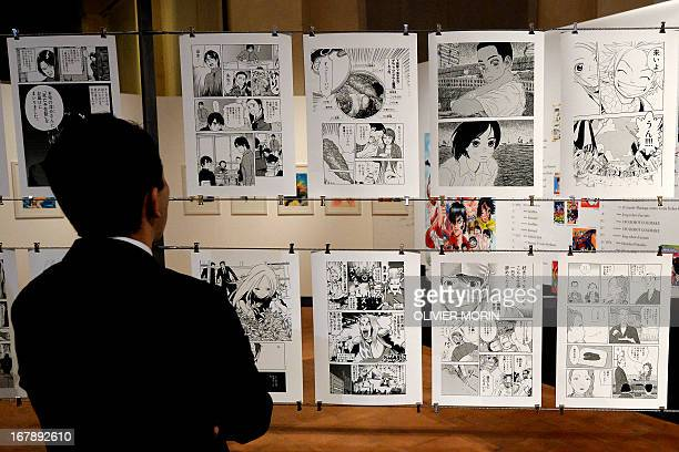 A visitors walks in the time tunnel exhibit of the 'Milano Manga Festival' on May 2 2013 during the press preview in Milan The exhibition tracing the...