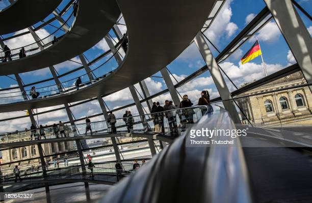 Visitors walks inside the cupola of the German Bundestag at Reichstags Building on October 01 2013 in Berlin Germany