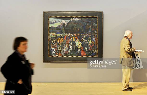 Visitors walks past the painting dated 1907 'Das bunte Leben' by Russian painter Wassily Kandinsky during the press preview of the exhibition...