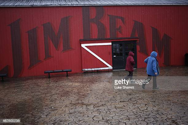 Visitors walks past the tasting room while on a distillery tour at the Jim Beam Bourbon Distillery January 13 2014 in Clermont Kentucky Japanese...