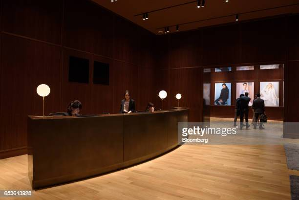Visitors walks through the reception area of Fast Retailing Co's Uniqlo City Tokyo office in Tokyo Japan on Friday March 10 2017 Uniqlo owner Fast...
