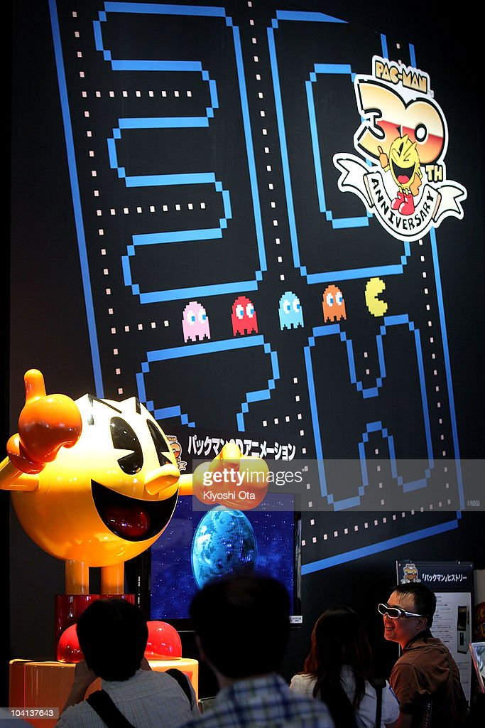 Visitors watch 3D images of Namco Bandai Games Inc.'s 'Pac-Man' projected on a screen during the Tokyo Game Show 2010 at Makuhari Messe on September 16, 2010 in Chiba, Japan. The computer and video game convention, which will be held until September 19, features exhibitions of upcoming game software and hardware from 194 companies and organizations to draw business visitors and the general public.