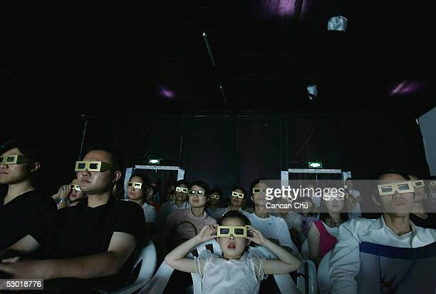 Visitors watch a 3D cartoon film the first International Animation Festival and Exposition on June 2 2005 in Hangzhou capital city of Zhejiang...