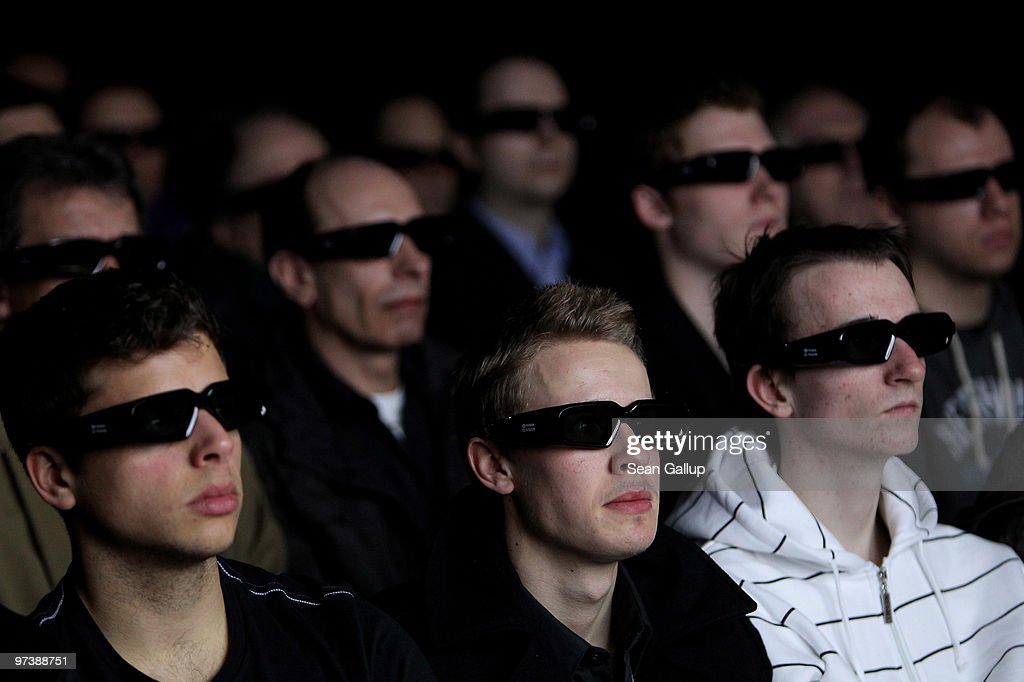Visitors watch a 3D cinematic demonstration promoting NVIDIA graphic processors at the CeBIT Technology Fair on March 3, 2010 in Hannover, Germany. CeBIT will be open to the public from March 2 through March 6.