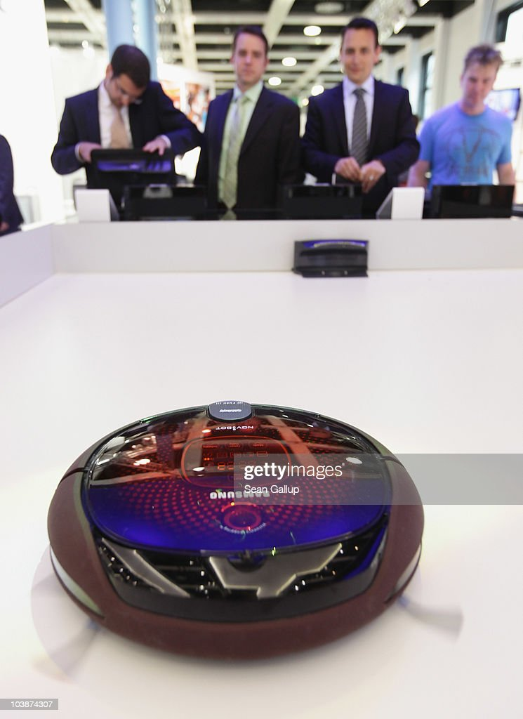 Visitors watch a NaviBot robotic vacuum cleaner in action at the Samsung home appliances stand at the 2010 IFA technology trade fair at Messe Berlin on September 7, 2010 in Berlin, Germany. The IFA 2010 is open to the public from September 3-8.