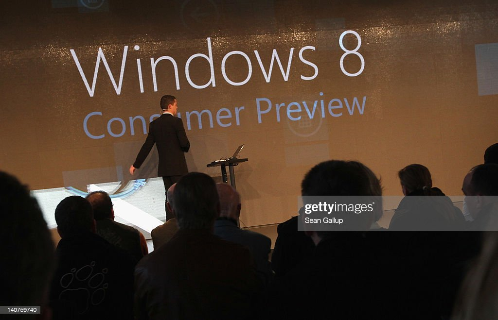 Visitors watch a presentaiton of fetaures of the new Windows 8 operating system at the Microsoft stand on the first day of the CeBIT 2012 technology...