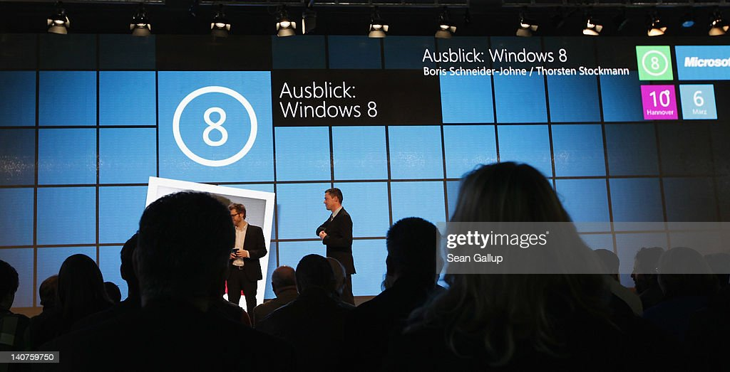 Visitors watch a presentaiton of fetaures of the new Windows 8 operating system at the Microsoft stand on the first day of the CeBIT 2012 technology trade fair on March 6, 2012 in Hanover, Germany. CeBIT 2012, the world's largest information technology trade fair, will run from March 6-10, and advances in cloud computing and security are major features this year.