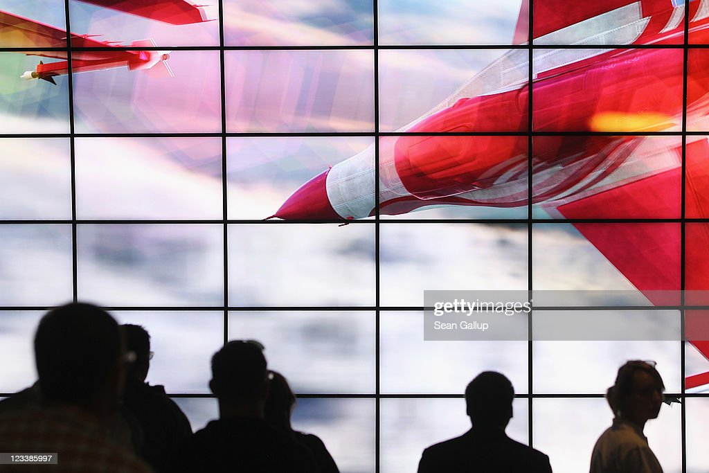 Visitors watch a presentation of 3D Smart TV at the LG stand at the IFA 2011 consumer technology trade fair on the first day of the fair's official opening on September 2, 2011 in Berlin, Germany. The IFA 2011 will be open to the public from September 2-7.