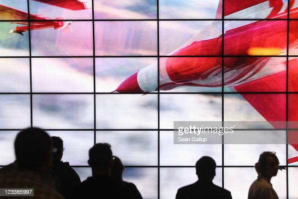 Visitors watch a presentation of 3D Smart TV at the LG stand at the IFA 2011 consumer technology trade fair on the first day of the fair's official...