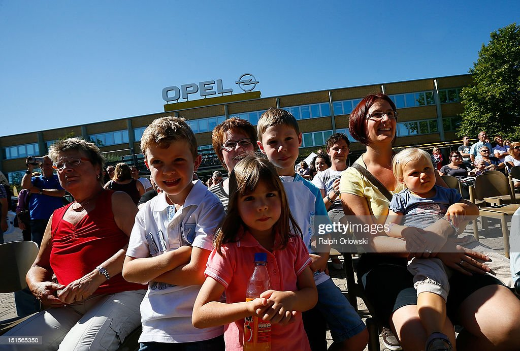 Visitors watch a show at the manufacturing plant of German car maker Adam Opel GmbH on September 8, 2012 in Kaiserslautern, Germany. Automaker Opel, founded in 1862, celebrates their 150th anniversary.