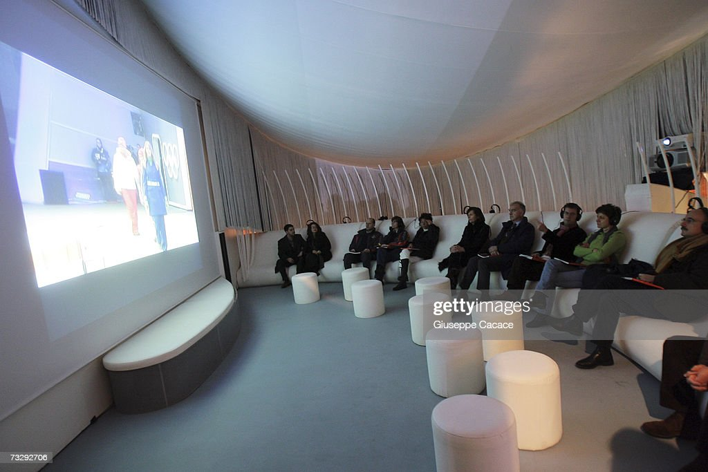 Visitors watch a video during the opening ceremony for the Olympic Museum at Atrium on February 10, 2007 in Turin, Italy.