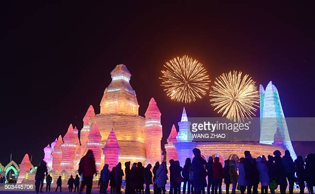 TOPSHOT Visitors watch fireworks at the China Ice and Snow World during the opening ceremony of the Harbin International Ice and Snow Festival in...