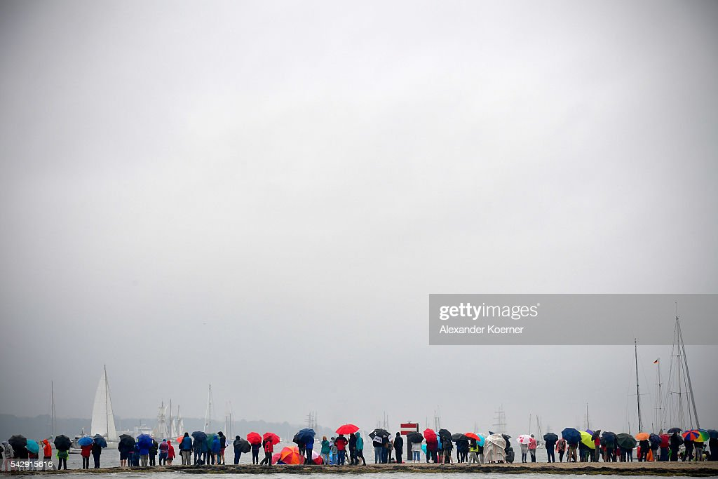 Visitors watch from a beach the sailing ship 'Thor Heyerdahl' and others while sailing out of the Bay of Kiel during the annual Windjammer parade on June 25, 2016 in Kiel, Germany. The annual Tall Ships Parade, in which many of the world's largest traditional sailing ships participate, is the highlight of the Kieler Woche (Kiel Week), the world's biggest regatta and sailing event.