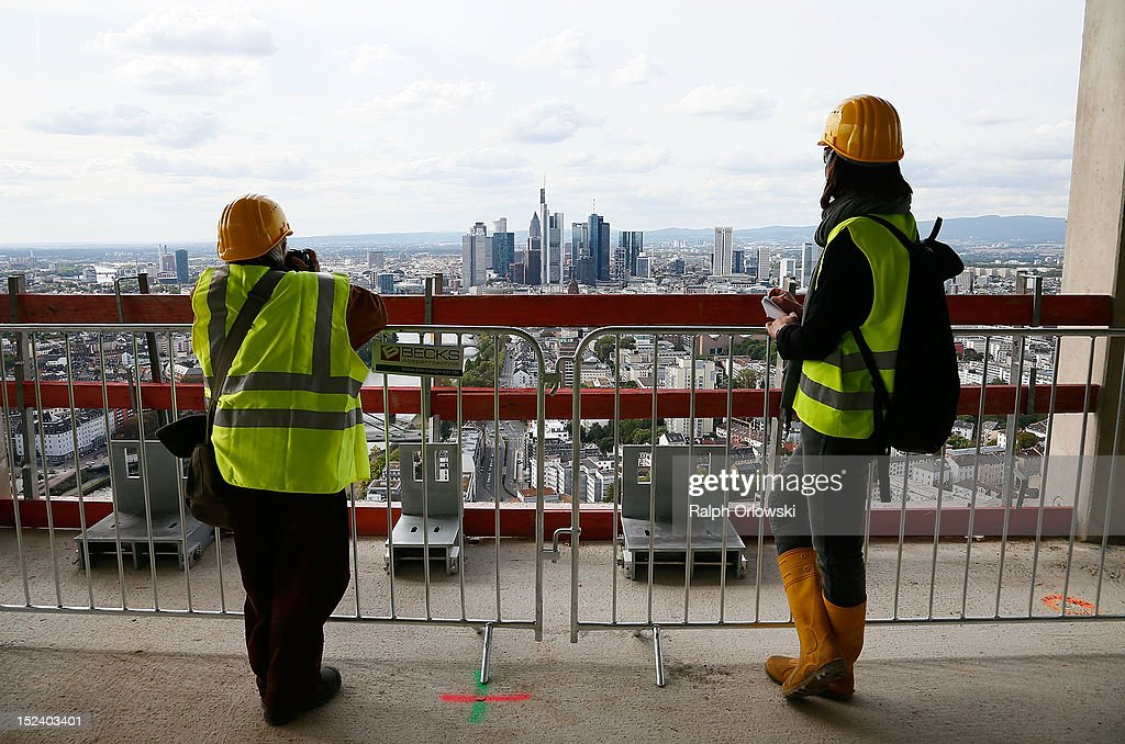 Visitors watch from the top floor of the construction site of the new European Central Bank (ECB) headquarters during a media tour on September 20, 2012 in Frankfurt, Germany. The new, twin-tower headquarters is scheduled for completion by 2014.