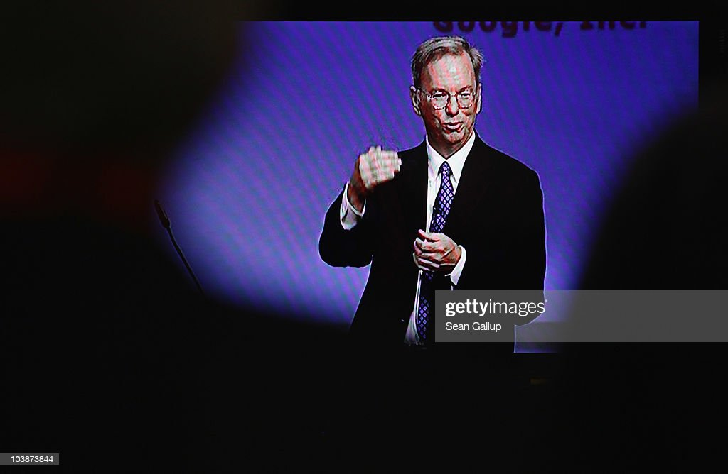 Visitors watch Google Chairman and CEO <a gi-track='captionPersonalityLinkClicked' href=/galleries/search?phrase=Eric+Schmidt&family=editorial&specificpeople=5515021 ng-click='$event.stopPropagation()'>Eric Schmidt</a> deliver the closing keynote speech on a television at the 2010 IFA technology trade fair at Messe Berlin on September 7, 2010 in Berlin, Germany. The IFA 2010 is open to the public from September 3-8.