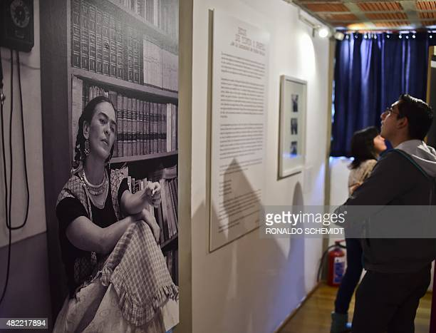 Visitors watch letters written by Mexican painter Frida Kahlo displayed at the 'Casa Estudio Diego Rivera y Frida Kahlo' museum in Mexico City on...