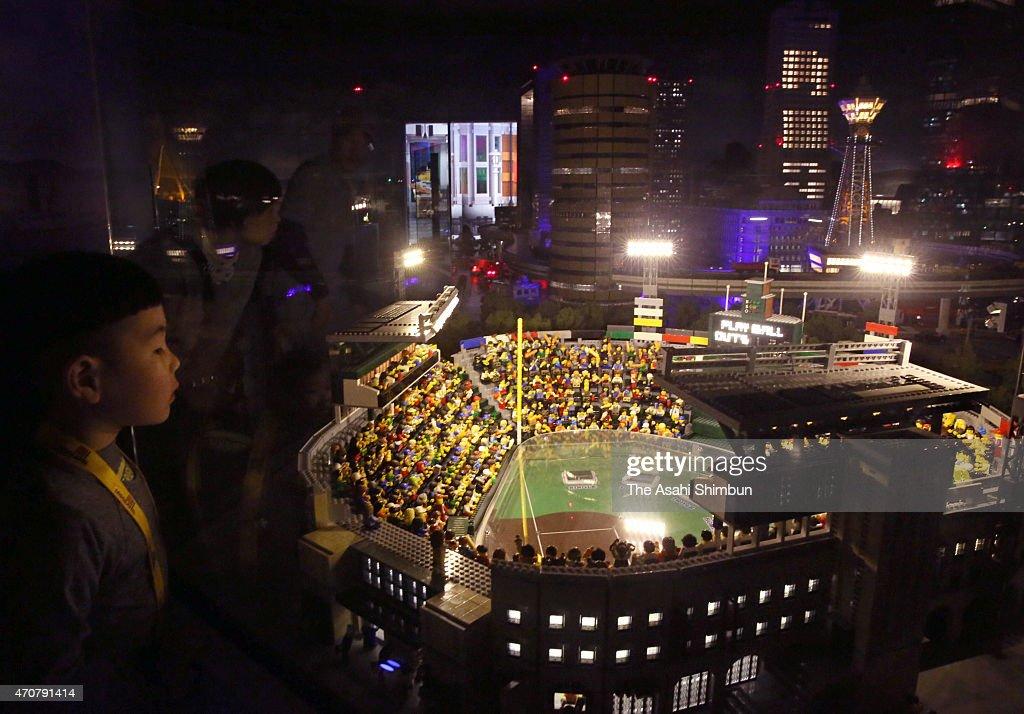 Visitors watch Osaka cityscape of Koshien Stadium made by Lego blocks at the newly opened Legoland Discovery Center Osaka on April 23 2015 in Osaka...