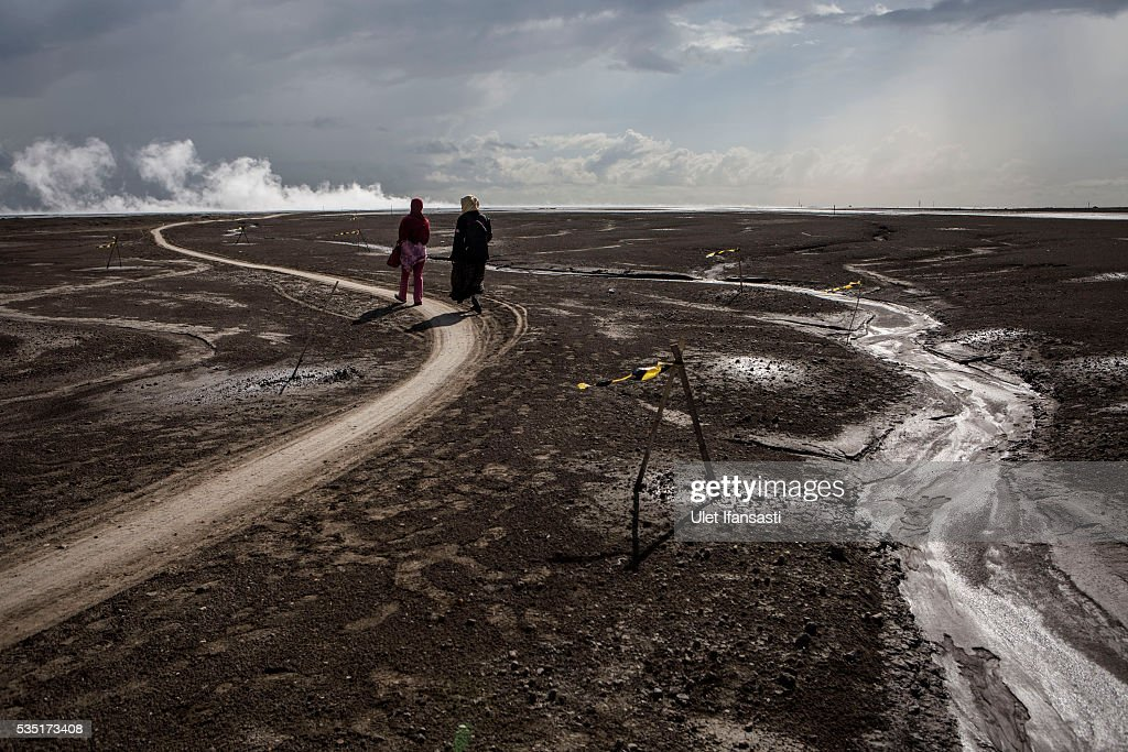 Visitors watch smoke coming out from the mudflow during the tenth anniversary of the mudflow eruption on May 29, 2016 in Sidoarjo, East Java, Indonesia. Residents of villages which were damaged by the Sidoarjo mudflow have finally received compensation from the Indonesian oil and gas company, PT Lapindo Brantas, after almost ten years. The mudflow eruption is suspected to have been triggered by the drilling activities of the oil and gas company, though they refute the claims, instead blaming a 6.3 magnitude earthquake which struck the neighbouring city of Yogyakarta, a city 150 miles west of a drill site in Sidoarjo, two days before the mudflow eruption on May 27th, 2006. According to reports, twenty lives were lost and nearly 40,000 people displaced, with damages topping USD 2.7 billion. Ten years on since the eruption the mud geysers still continue to spurt mud out on a daily basis and high levels of heavy metals have been detected in nearby rivers.