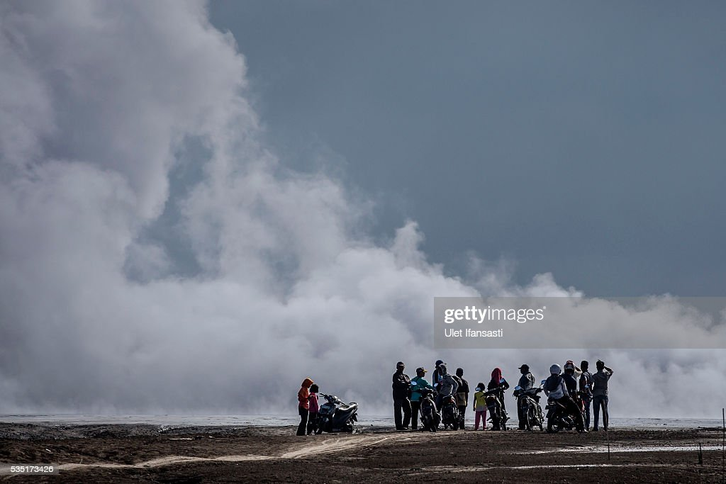Visitors watch smoke emerge from the mudflow during the tenth anniversary of the mudflow eruption on May 29, 2016 in Sidoarjo, East Java, Indonesia. Residents of villages which were damaged by the Sidoarjo mudflow have finally received compensation from the Indonesian oil and gas company, PT Lapindo Brantas, after almost ten years. The mudflow eruption is suspected to have been triggered by the drilling activities of the oil and gas company, though they refute the claims, instead blaming a 6.3 magnitude earthquake which struck the neighbouring city of Yogyakarta, a city 150 miles west of a drill site in Sidoarjo, two days before the mudflow eruption on May 27th, 2006. According to reports, twenty lives were lost and nearly 40,000 people displaced, with damages topping USD 2.7 billion. Ten years on since the eruption the mud geysers still continue to spurt mud out on a daily basis and high levels of heavy metals have been detected in nearby rivers.
