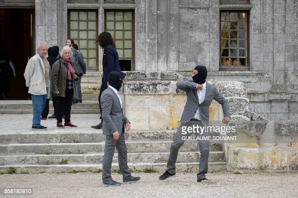 Visitors watch stunt performers training at the Chateau of Chambord on October 5 2017 during the shooting of the Indian action film 'Junga' The film...