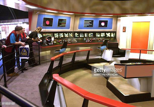 Visitors watch the flight deck of the Starship Enterprise space vessel displayed 18 December 2002 at the Star Trek convention in Hyde Park London