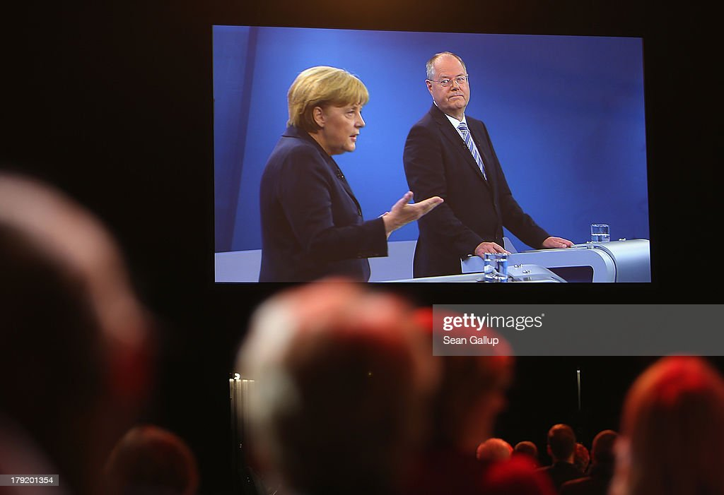 Visitors watch the live television debate between German Chancellor and Christian Democrat (CDU) Angela Merkel and Social Democrats (SPD) chancellor candidate Peer Steinbrueck at the Adlershof studios on September 1, 2013 in Berlin, Germany. Today's live debate is the only one between the two candidates ahead of German elections scheduled for September 22.